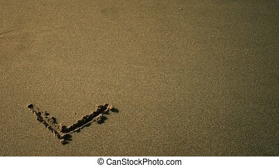 The word love is drawn in the sand
