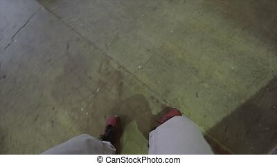 Roller skater ride in skate park, hold camera in hands. Extreme sport. Surface. Movement