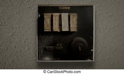 A old-style fuse box The Switch flicks up and down and the...