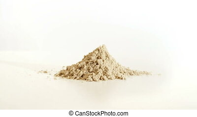 Pile of sand rises from the ground - A pile of sand rises...