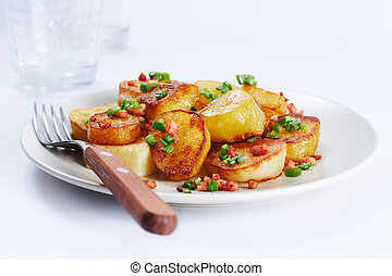 Fried potatoes - Image of fried potatoes with green leek