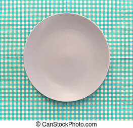 the plate on checkered tablecloth