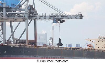 Unloading a huge ship - Unloading coal from a bulk carrier...