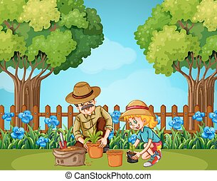 Girl and grandfather planting in the garden