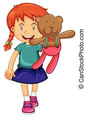 Little girl holding brown teddy bear