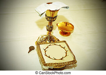 Golden Chalice with consecrated hosts in a Christian Church...
