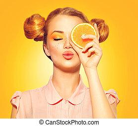 Beauty model girl takes juicy oranges