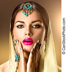 Beauty Indian woman portrait. Model girl with mehndi tattoo on her hands