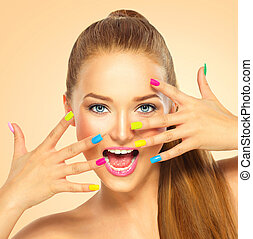 Beauty girl with colorful nail polish. Manicure and makeup