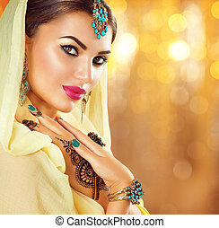 Arabic beauty girl with black henna tattoos and jewels