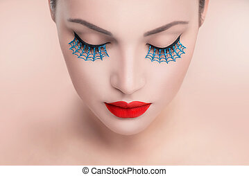Beauty fashion model woman face. Portrait with red sexy lips and blue false eyelashes