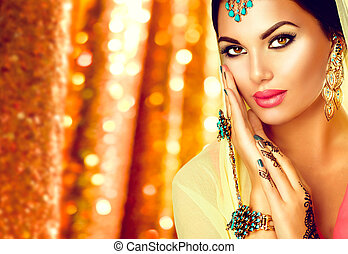 Young arabian woman with mehndi tattoo, perfect make-up and accessories