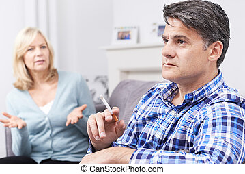 Mature Couple Arguing Over Smoking At Home