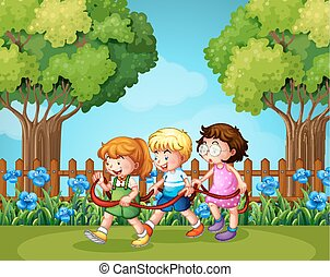 Three kids playing in the garden