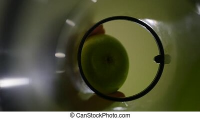 Put fresh green Apple in juicer for Juice. slow motion