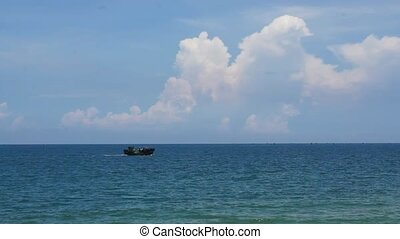 Small fishing boat crossing ocean - Small fishing boat...