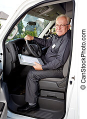 Elderly delivery man in a car.