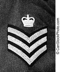 Her Majesty\'s Sergeant - Military sergeant\'s uniform crest...