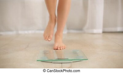 Female Standing on Weight Scale clip