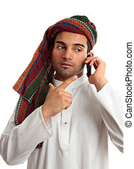 Middle eastern businessman on phone - A middle eastern...