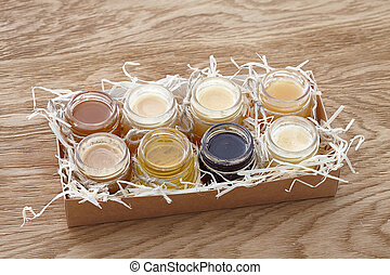 Different kinds of honey in a box