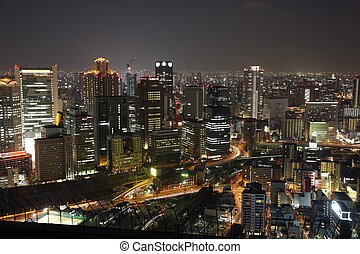 Illuminated Osaka City in Japan at night from high above