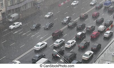 Traffic on highway during winter snow storm