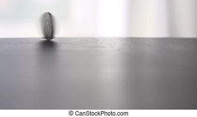One coin rotates clip on table