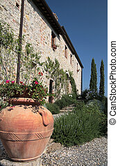 Traditional country side house in Tuscany, Italy -...