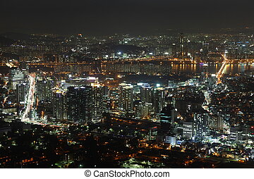 Illuminated Seoul City in South Korea at night from high...