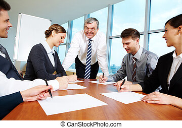 Working in group - Smart and confident boss looking at...