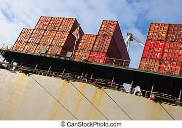 stack of cargo freight container on ship at harbour terminal