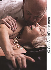 You are the love of my life - Mature man and woman lying on...