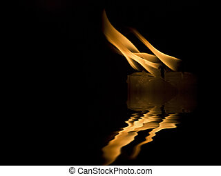 A Midnight\'s Breeze - Three candles being blown by a gentle...