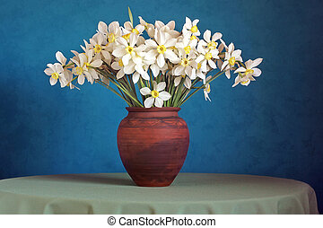 Bouquet of daffodils in a clay jug on a blue background.