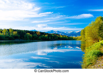 Beautiful landscape, Lake and snow mountain in background.