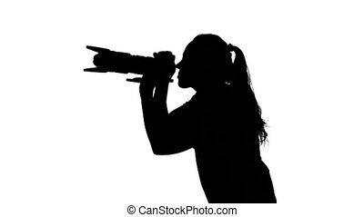 Photographer changes views. White. Silhouette - Photographer...