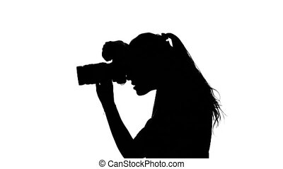 Photographer shows the thumb. White. Silhouette - Female...