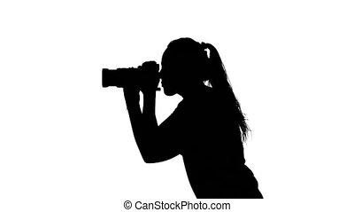 Photographer taking photos and is rotating White Silhouette...