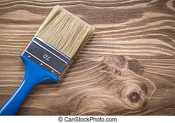 Paint brush on wooden board directly above construction...