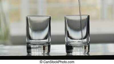 pouring glass with alcohol