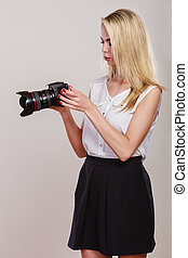 Beautiful woman with camera - Photographer girl shooting...