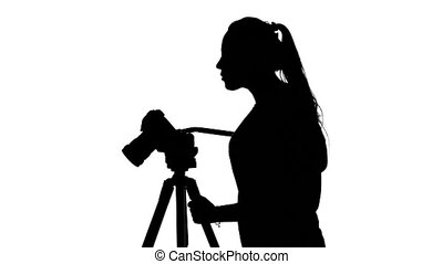 Operator makes shooting in the Studio. White. Silhouette -...
