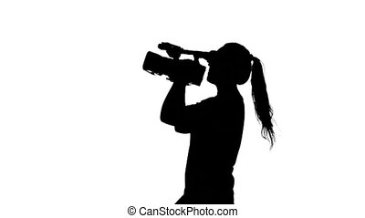 Girl shoots video or movie White Silhouette - Videographer...