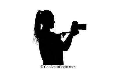 Operator whith body tripod. White. Silhouette - Girl...