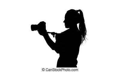 Videography in the studio. Body tripod. White. Silhouette -...