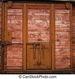 View of old door - An old metal closed door with wooden...