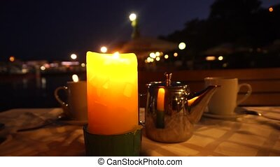 One candle on a tea-table
