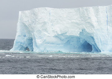 Arched Iceberg - Arched blue glacial iceberg in Antarctica.