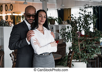 Portrait of an Arab businessman with a girl